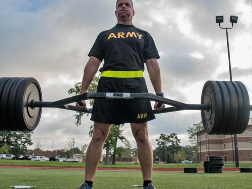 A TRADOC senior leader participates tries out a deadlift during an exhibition of the new Army Combat Fitness Test, at Joint Base Langley-Eustis, Virginia. (Senior Airman Tristan Biese/Air Force)