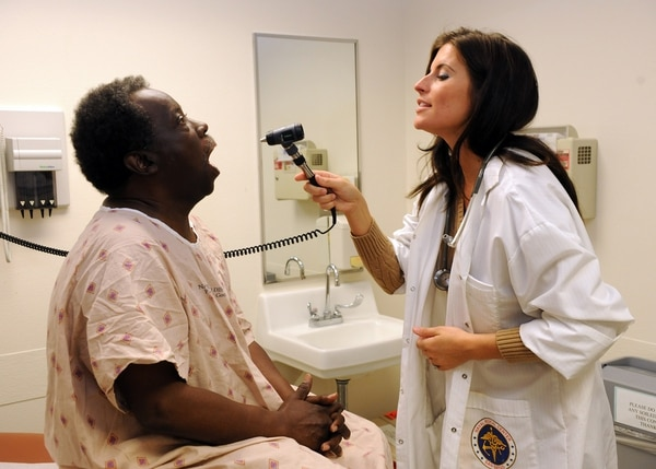 Nurse practitioner Tiffany Holm performs a routine physical on Willie Benjamin at the Tricare Outpatient Clinic-Clairemont Mesa operated by Naval Medical Center San Diego. (Petty Officer 2nd Class Chelsea A. Blom/Navy)