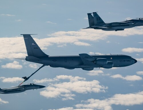 Two F-15C Eagles from the 44th Fighter Squadron refuel with a KC-135 Stratotanker from the 909th Air Refueling Squadron Jan. 10 during exercise WestPac Rumrunner out of Kadena Air Base, Japan. Rumrunner represents an evolution in the capabilities of 18th Wing assets to work with joint partners. (Senior Airman Matthew Seefeldt/Air Force)