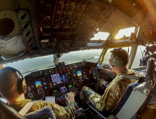 U.S. Air Force Capt. Brandon Johnson, left, and Lt. Col. Martin Ryan fly a KC-135R Stratotanker during a training mission at Joint Base McGuire-Dix-Lakehurst, N.J., July 27, 2021. (Master Sgt. Matt Hecht/Air National Guard)
