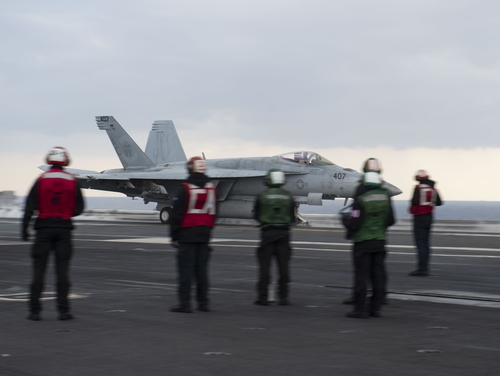 An F/A-18E Super Hornet, attached to the