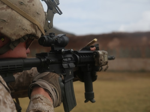 Sgt. William Francis Coffey II fires an M4 5.56mm carbine rifle April 2015. In 2018 the Marine Corps will be adopting the Army's enhanced 5.56mm rifle round for Marines in combat. (Lance Cpl. Adam O. Korolev/Marine Corps)