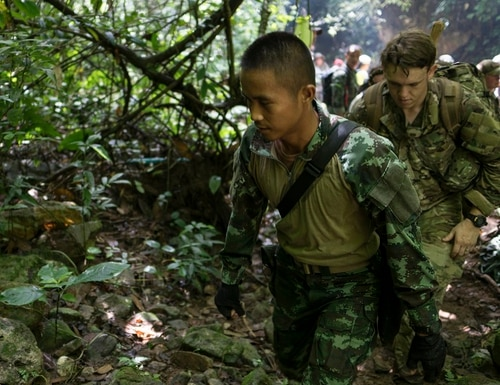 Airmen from U.S. Indo-Pacific Command conduct a combined land survey with Thai rescue authorities earlier this week at Chiang Rai, Thailand. The airmen are part of an international effort led by the Thai military to rescue 12 boys and their soccer coach trapped inside the Tham Luang Cave since June 23. (Capt. Jessica Tait/Air Force)