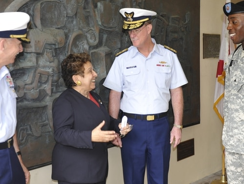 Then-University of Miami President Donna Shalala meets with Coast Guard and Army personnel after a 2009 Veterans Day ceremony in Coral Gables. (Coast Guard)