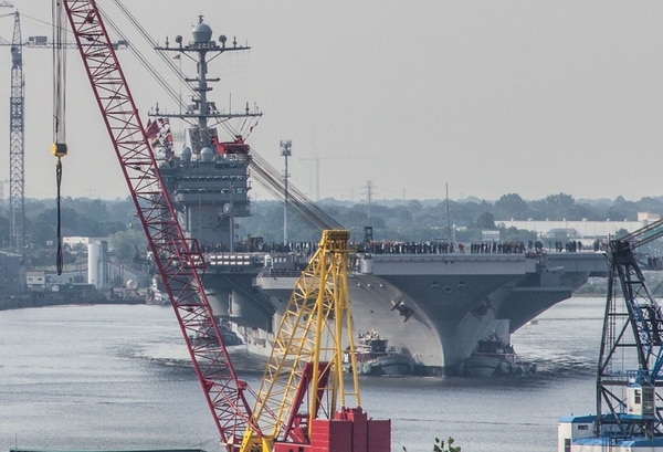 Norfolk, Va. (July 21, 2017) The aircraft carrier Harry S. Truman moves through downtown Norfok as part of her transit from Norfolk Naval Shipyard while heading to sea for trials after a 10-month yard period.