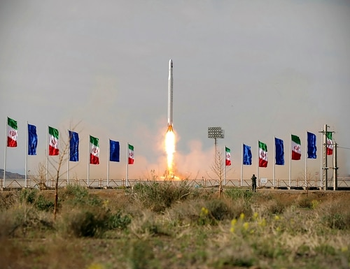 An Iranian rocket carrying a satellite is launched from an undisclosed site believed to be in Iran's Semnan province. (Sepahnews via AP)
