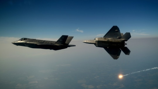 An F-35A and an F-22A fly together for the first time in 2012. (Master Sgt. Jeremy Lock/U.S. Air Force)