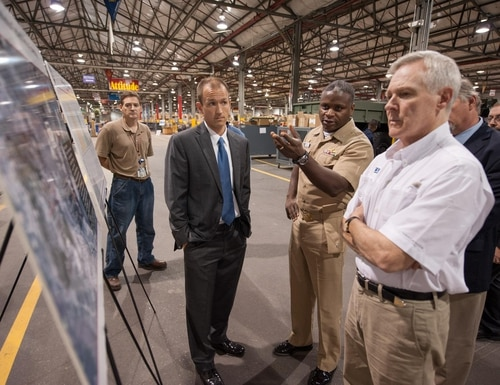 Navy Capt. Mark Glover briefs Secretary of the Navy Ray Mabus at the MRAP C4I integration facility at SPAWAR Systems Center Atlantic (Charleston, S.C.).=