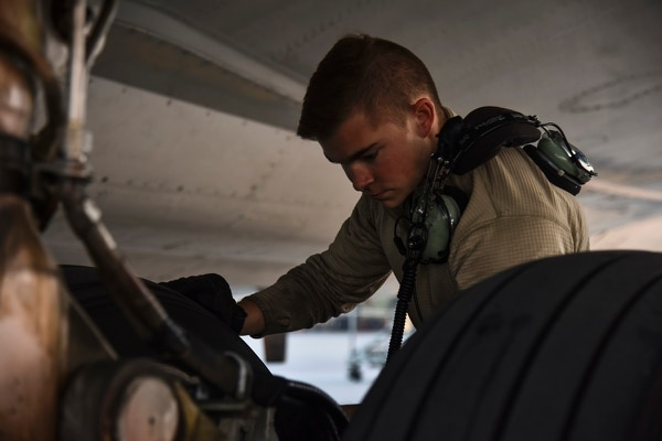 Air Force maintenance teams check a tire as part of a routine inspection. (Senior Airman Mya M. Crosby/U.S. Air Force)