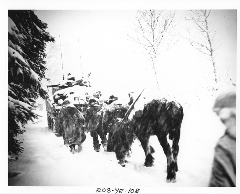 The weather during the battle for northwestern Europe in 1944-45 was unusually frigid. Here's what it was like for U.S. infantrymen, who were photographed trudging behind an armored vehicle in the snow-covered Ardennes Forest. (National Archives)