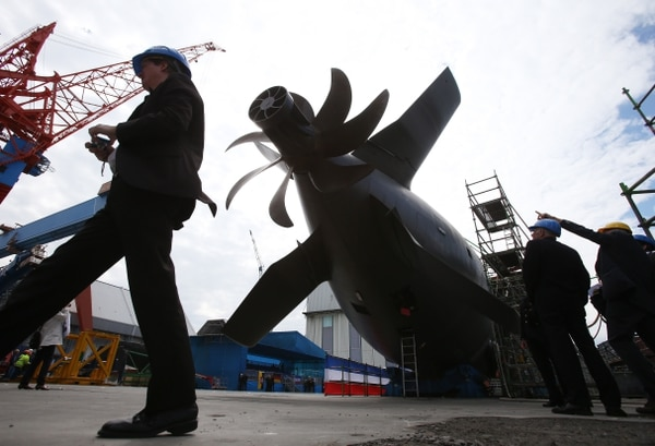 Shipyard workers and German soldiers attend the christening of the U36 submarine of the 212A class at the ThyssenKrupp Marine Systems shipyard in Kiel, northern Germany, on May 15, 2013. (Christian Charisius/AFP via Getty Images)