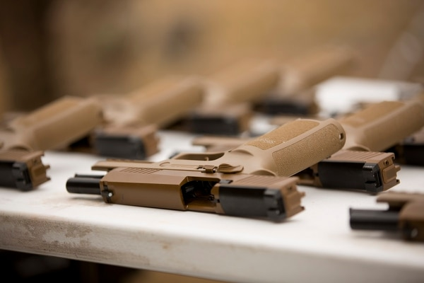 The Army's new Modular Handgun System, or M17, will be issued to soldiers over the next 10 years. (Daniel Woolfolk/Staff)