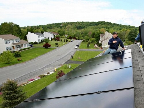 Veterans won't need to cover their roof in solar panels to take advantage of VA's energy-efficiency loan program. (Craig Ruttle/AP)
