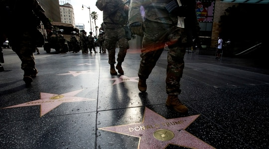 Members of National Guard walk past Donald Trump's star on the Hollywood Walk of Fame on Tuesday, June 2, 2020, in the Hollywood section of Los Angeles. (Ringo H.W. Chiu/AP)