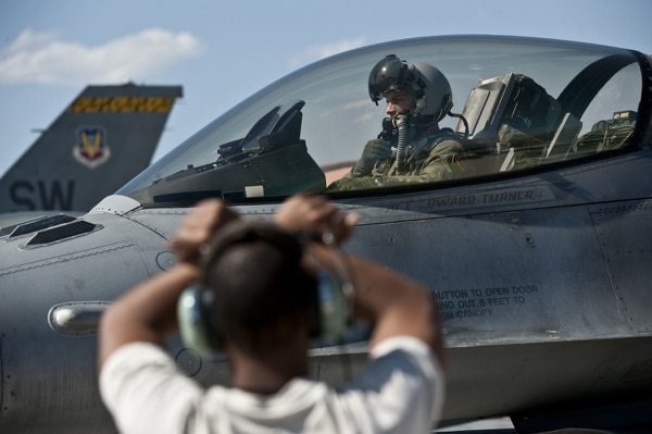 Capt. Jeremy Nolting awaits clearance to taxi his F-16 Fighting Falcon out for a training mission. The Air Force hopes a 4,700-airman increase in fiscal 2019 will help it reduce a pilot shortfall. (Tech. Sgt. Michael R. Holzworth/Air Force)