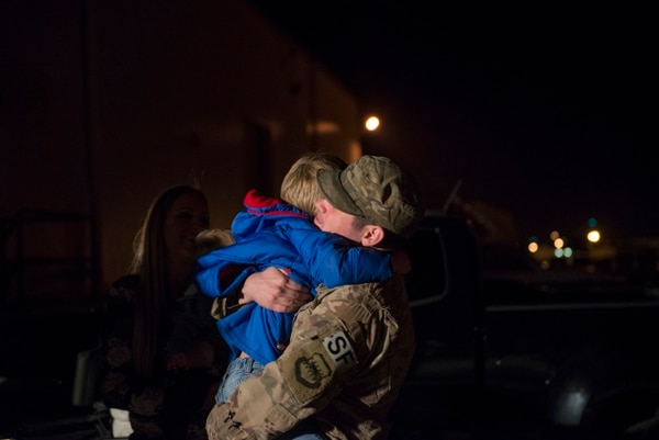 Staff Sgt. Issac McCauley, 436th Security Forces Squadron defender, hugs his son after returning home from deployment to the Middle East, Jan. 21, 2018, at Dover Air Force Base, Del. McCauley was welcomed home by his family after his six-month long deployment. (Airman 1st Class Zoe M. Wockenfuss/Air Force)