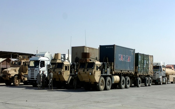 A convoy security element with Company A, 10th Brigade Support Battalion, 1st Brigade, 10th Mountain Division aligns a resupply convoy headed out of Forward Operating Base Warrior in Kirkuk, Iraq, in 2008. (Army via AP)