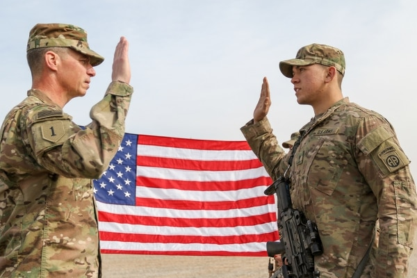 Maj. Gen. Joseph Martin reenlists an 82nd Airborne Division infantryman. A high retention rate is helping the Army drive up its end strength numbers. (Staff Sgt. Jason Hull/Army)