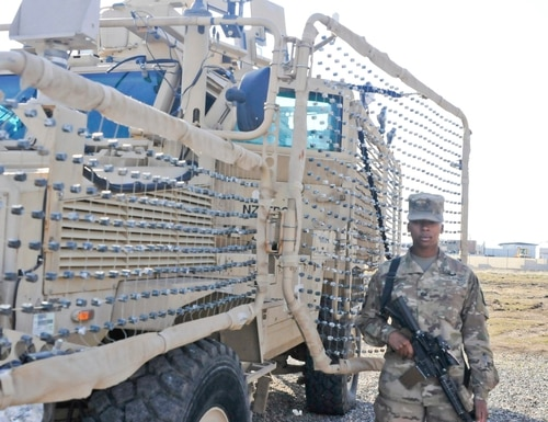 A female combat engineer deploys to Iraq. (Sgt. 1st Class Joel Quebec)