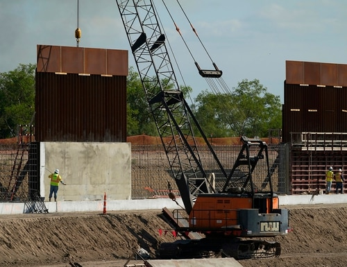 Construction workers build a border wall in Mission, Texas, Monday, Nov. 16, 2020. (Eric Gay/AP)