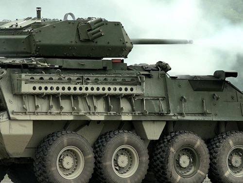The Stryker Infantry Carrier Vehicle - Dragoon fires its 30mm cannon at Aberdeen Proving Ground, Maryland, during a live-fire demonstration for reporters on August 15, 2017. (Alan Lessig/Staff)