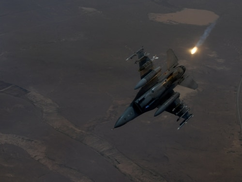 An F-16 Fighting Falcon deploys a flare over an undisclosed location on April 15, 2019. (Staff Sgt. Chris Drzazgowski/Air Force)