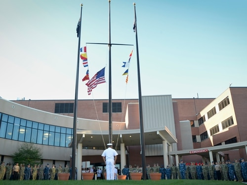 Sailors stand at attention during a 9/11 memorial ceremony at Captain James A. Lovell Federal Health Care Center in north Chicago in 2018. The Veterans Affairs hospital currently has the most active coronavirus cases of any department site, with 112. (Mass Communication Specialist 3rd Class Weston A. Mohr/Navy)