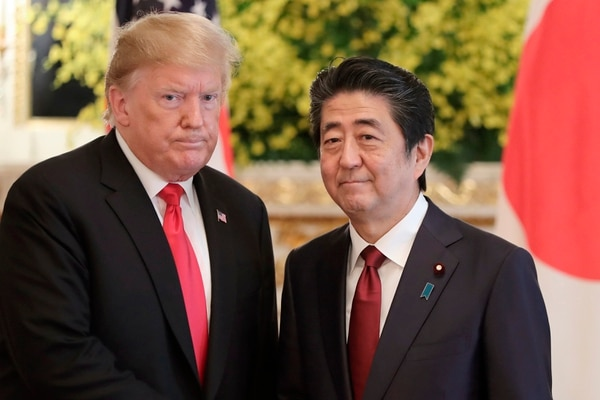 On May 27, President Donald Trump, left, and Japanese Prime Minister Shinzo Abe posed for a photo prior to their meeting at Akasaka Palace, Japanese state guest house, in Tokyo. (Eugene Hoshiko, Pool/AP)
