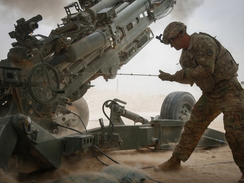 A solider assigned to Bravo Battery, Field Artillery Squadron, 3rd Cavalry Regiment, pulls the lanyard to fire a an M777A2 howitzer at Firebase Saham in Iraq on Oct. 24, 2018. A new report estimates the cost of the