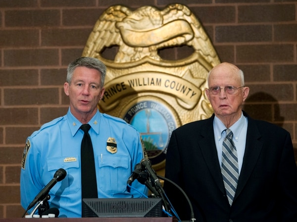 Prince William County Police Chief Stephan Hudson, left, accompanied by Prince William County Commonwealth Attorney Paul Ebert speaks during a news conference at the Western District Station, in Manassas, Va., Sunday, Feb. 28, 2016. Ronald Williams Hamilton is being held without bond in the Prince William County Adult Detention Center on charges that include murder of a law enforcement officer Saturday evening. (AP Photo/Jose Luis Magana)