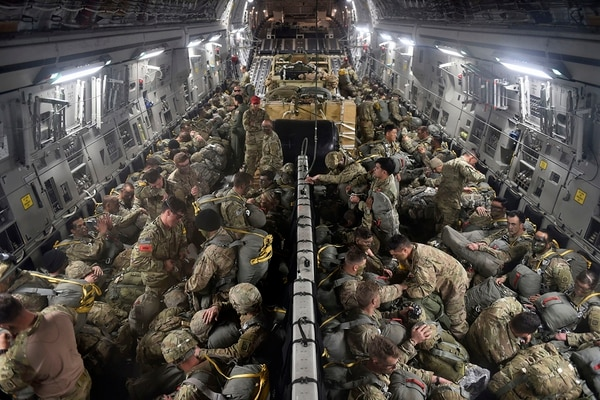 U.S. Army paratroopers assigned to the 2nd Brigade Combat Team, 82nd Airborne Division, stationed at Fort Bragg, N.C., load onto a C-17 Globemaster III aircraft, during the Joint Readiness Training Center exercise, April 7, 2018, at the Alexandria International Airport, La. (Tech. Sgt. Liliana Moreno/Air Force)