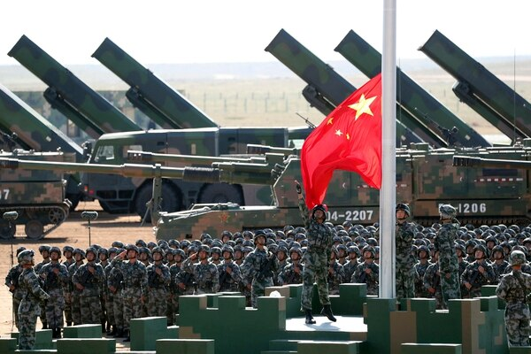 U.S. Air Force Chief of Staff Gen. CQ Brown has made clear the service must divest portions of its legacy fleet to free up funding for investments in advanced technologies to outmatch China, whose troops are shown here in July 2017. (Pang Xinglei/Xinhua via AP)