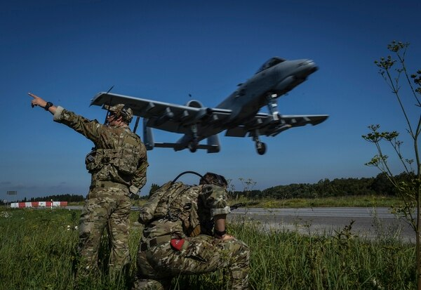 Combat controllers with the 321st Special Tactics Squdron guide an A-10 Thunderbolt II pilot for a landing on the Jägala-Käravete Highway in Estonia. (Senior Airman Ryan Conroy/Air Force)