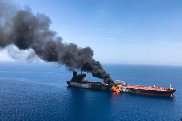 An oil tanker burns on June 13 in the sea of Oman. (AP Photo/ISNA)