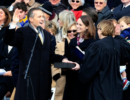 Missouri Gov. Eric Greitens takes the oath of office during a ceremony on the steps of the capitol in Jefferson City, Mo., Monday, Jan. 9, 2017. Looking on is his wife, Sheena. (AP Photo/Orlin Wagner)