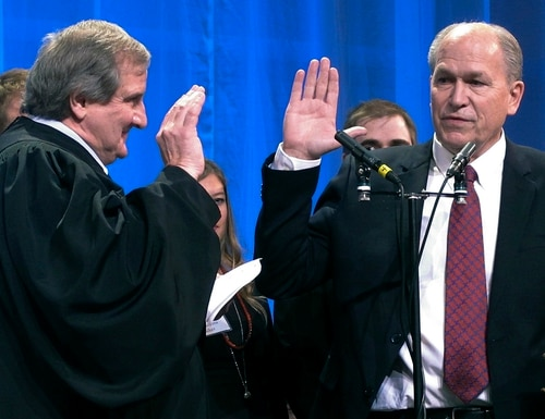 Bill Walker, right, is sworn in as Alaska's new governor as Alaska Supreme Court Justice Daniel Winfree, left, administers the oath of office on Monday, Dec. 1, 2014, in Juneau, Alaska. The Bible on which Walker took his oath has been in his family since the 1800s, according to his spokeswoman. (AP Photo/Becky Bohrer)