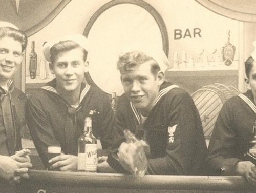 Sailors from the destroyer escort Rinehart drinking faux booze in a staged souvenir photo at Radio City Music Hall during World War II. The bottles were empty. And that's not because they were using the grain alcohol to make hand sanitizer. Don't do that. (a gift from William Schultz, now in the collections of U.S. Naval History and Heritage Command)