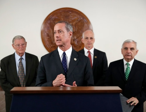 Senate Armed Services Committee Chairman Jim Inhofe, R-Okla., left, stands as House Armed Services Chairman Mac Thornberry, R-Texas, second from left, speaks at a press conference on Capitol Hill on July 11, 2018. With them are HASC ranking member Rep. Adam Smith, D-Wash., second from right, and SASC ranking member Sen. Jack Reed, D-R.I., right. Both Smith and Thornberry are up for re-election this fall. (Alex Brandon/AP)