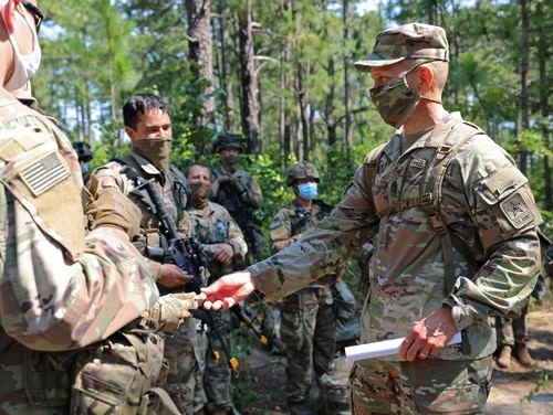 Sergeant Major of the Army Michael Grinston visits the 82nd Airborne Division during training at Fort Bragg, North Carolina, in June. (Staff Sgt. Kyle Castrovinci/Army)