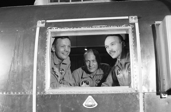 On July 27, 1969, Apollo 11 crew members, from left, Neil Armstrong, Buzz Aldrin and Michael Collins sit inside a quarantine van in Houston. (AP)