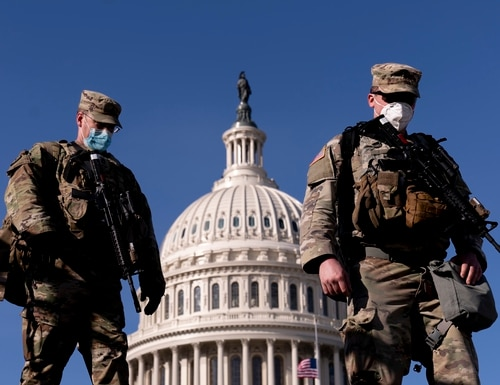 Members of the National Guard walk past the Dome of the Capitol Building on Capitol Hill in Washington, Thursday, Jan. 14, 2021. (Andrew Harnik/AP)