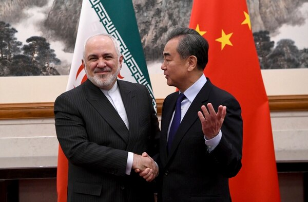 Chinese Foreign Minister Wang Yi, right, shakes hands with Iranian Foreign Minister Mohammad Javad Zarif during a meeting at the Diaoyutai state guest house in Beijing. (Noel Celis/AP)