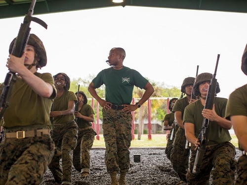 Sgt. Jamel Munden, a martial arts instructor with Support Battalion, supervises recruits of Papa Company, 4th Recruit Training Battalion, as they practice martial arts April 23, 2018, on Parris Island, South Carolina. (Cpl. Joseph Jacob/Marine Corps)