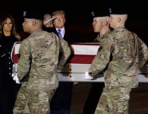 President Donald Trump and first lady Melania Trump watch as a U.S. Army carry team moves a transfer case containing the remains of Chief Warrant Officer 2 David C. Knadle, of Tarrant, Texas, Thursday, Nov. 21, 2019, at Dover Air Force Base, Del. (Evan Vucci/AP)