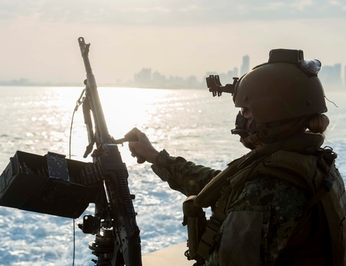 A sailor stands watch aboard a Mark VI patrol boat in the Persian Gulf while escorting Army vessels out of the region July 13. (Jordan Bair/Navy)