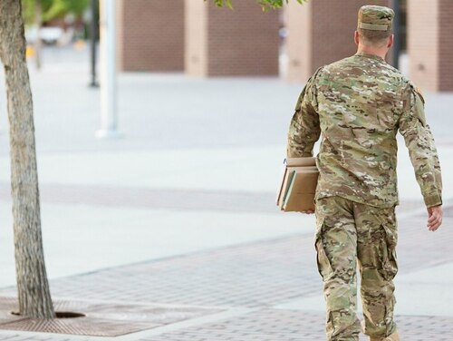 Some argue that the 90-10 rule incentivizes for-profit colleges to target veterans and troops for enrollment, sometimes in a predatory manner. (Getty Images)