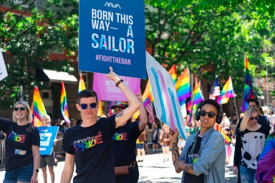 Lindsay Church, executive director and co-founder of Minority Veterans of America (center left), and other members of the group march in the Seattle pride parade in June 2019. (Photo courtesy of MVA)