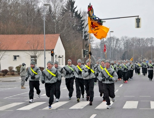 Army leaders with 2nd Cavalry Regiment run in the front of a regimental formation during a morale run March 28, 2013, at Rose Barracks, Germany. (Spc. Joshua Edwards/Army)