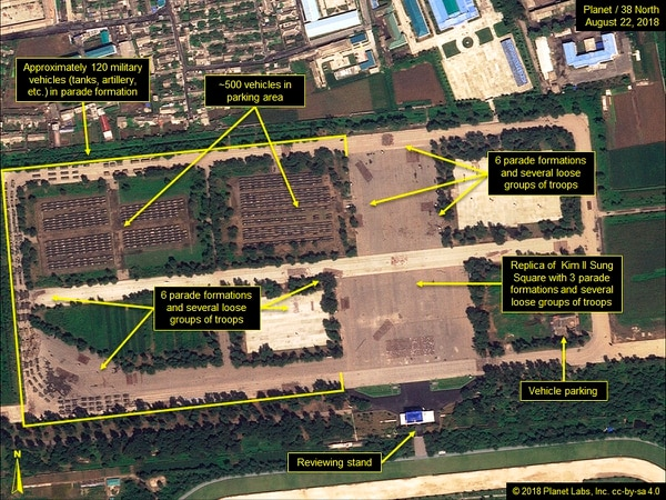 This Aug. 22, 2018, satellite image shows the Mirim Parade Training Ground with approximately 120 military vehicles in parade formation and groups of troops practicing on the roads and in a replica of Kim Il Sung Square. (Planet/38 North via AP)
