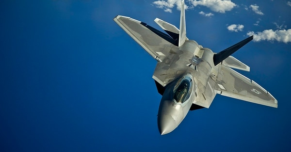 An F-22 Raptor from the Hawaii Air National Guard's 199th Fighter Squadron returns to a training mission after refueling in March 2012 over the Pacific Ocean near the Hawaiian Islands. (Tech. Sgt. Michael Holzworth/Air Force)